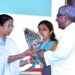 CM Ms Mamata Banerjee presented with the bouquet by Fr Felix Raj at the inauguration of the academic session at St Xavier's, Rajarhat